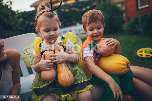 istock Kids with pumpkins ready for the Halloween 607737104