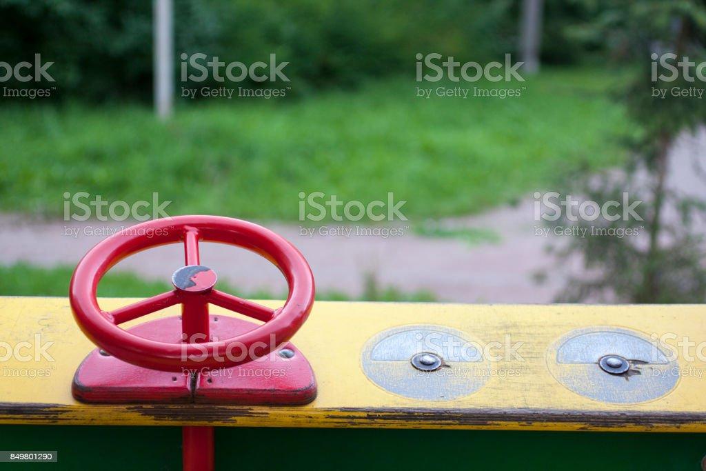 Kid's wooden car on children playground. stock photo