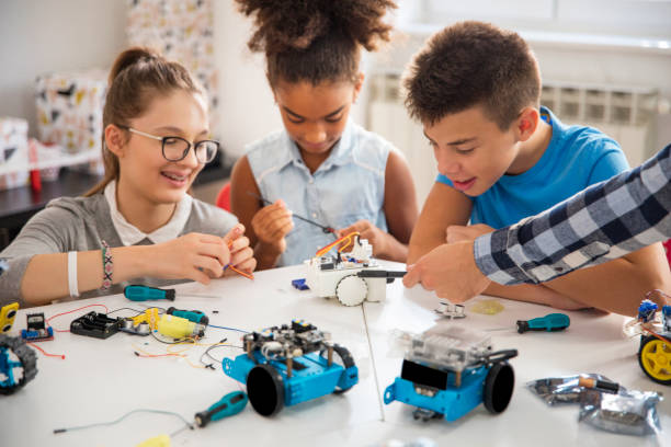 Kids working on a robot design stock photo