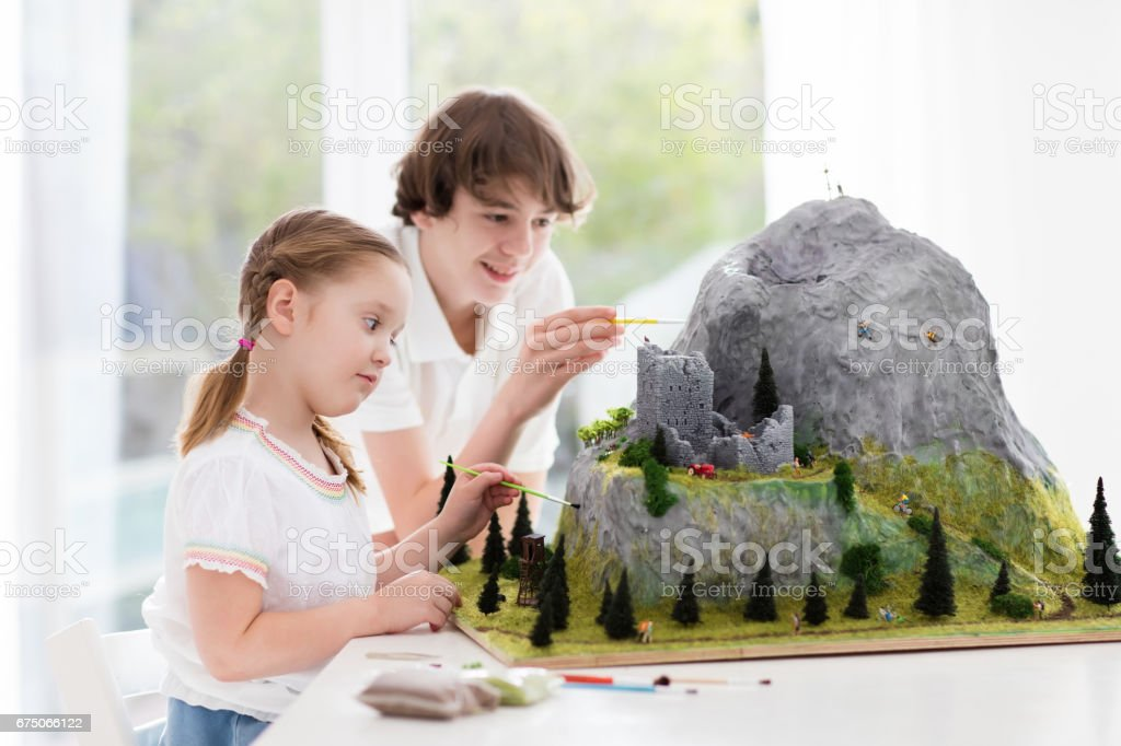 Kids working on model building project for school stock photo