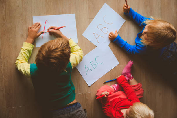 kids write letters, do homework stock photo