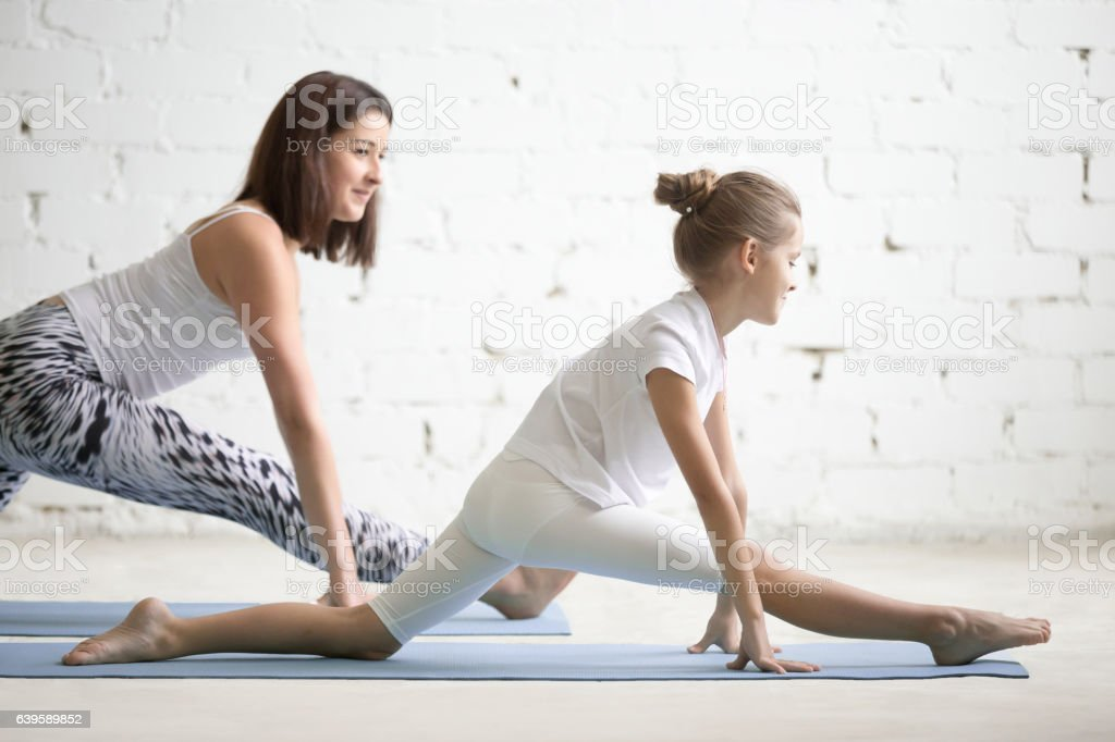 Kids Yoga Teacher Training With A Child A Hanumanasana Pose Stock Photo Download Image Now Istock