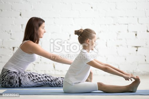 istock Kids yoga teacher training with a child a paschimottanasana pose 639589940