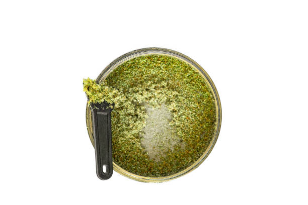 Kief in grinder for weed Trichomes buds of Cannabis macro top medical use THC and CBD - foto stock