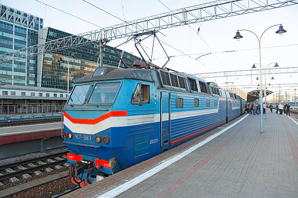 Kiev train waiting to depart Moscow Kievsky Station Moscow, Russia - April 27, 2012: Passengers congregate on the platform at Moscow's Kievsky Station while waiting to depart on the international train bound for Kiev, the Ukraine capital. depart stock pictures, royalty-free photos & images