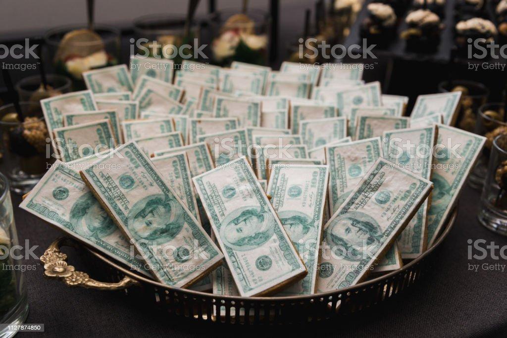 Kiev, Ukraine, 11.11.2018, beautiful cookies in the form of dollars stock photo