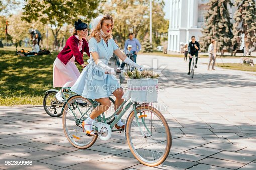 Kiev, Ukraine - May 12, 2018: Girl in retro clothes participating in bicycle tweed run Retro cruise on May 12, 2018 in Kiev, Ukraine.