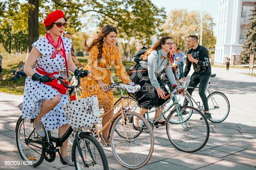 Kiev, Ukraine - May 12, 2018: Group of people in retro clothes participating in bicycle tweed run Retro cruise on May 12, 2018 in Kiev, Ukraine.