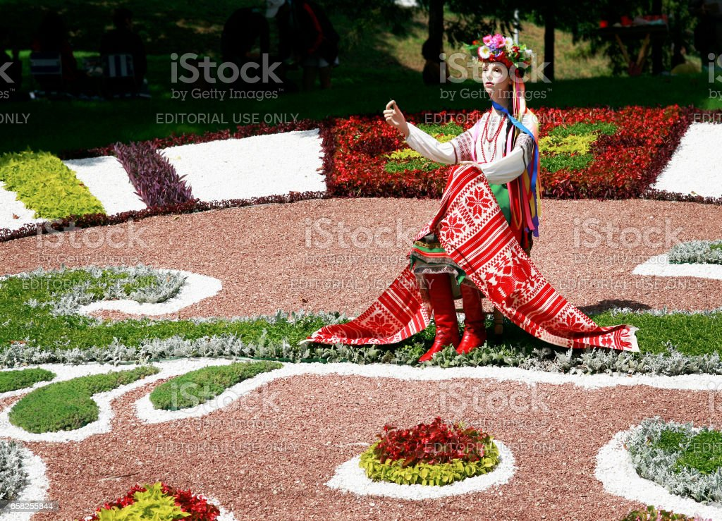 Kiev. Ukraine-August 25,2010: Annual flower show at the Song Festival Grounds. Flower Arrangement-Girl in Ukrainian Dress stock photo