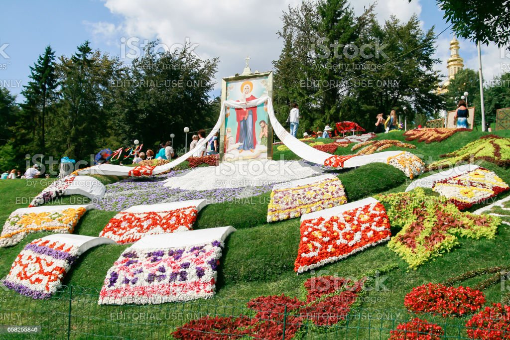Kiev. Ukraine-August 25,2010: Annual flower show at the Song Festival Grounds. Flower composition-rushnyky in Ukrainian style with different ornament stock photo