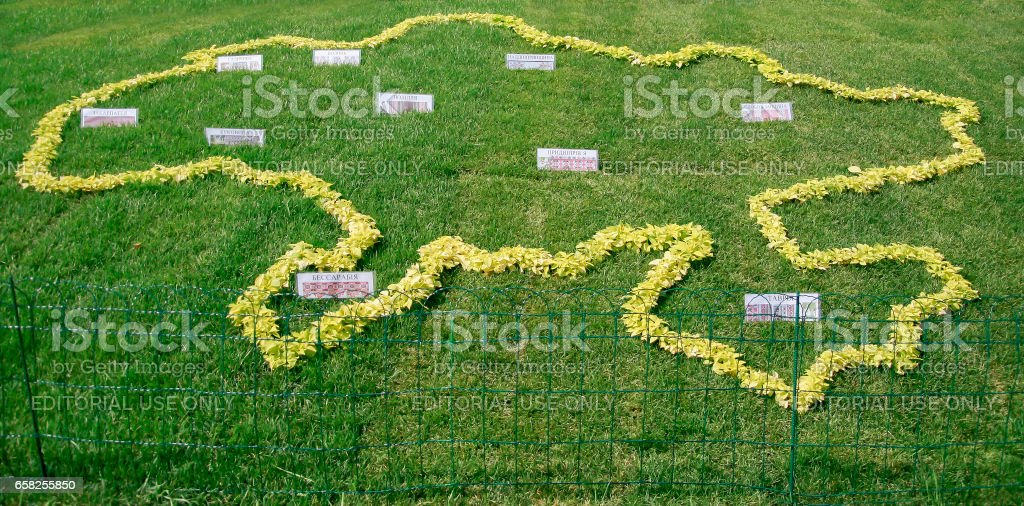 Kiev. Ukraine-August 25,2010: Annual flower show at the Song Festival Grounds. Flower composition-map of Ukraine with names of regions. stock photo