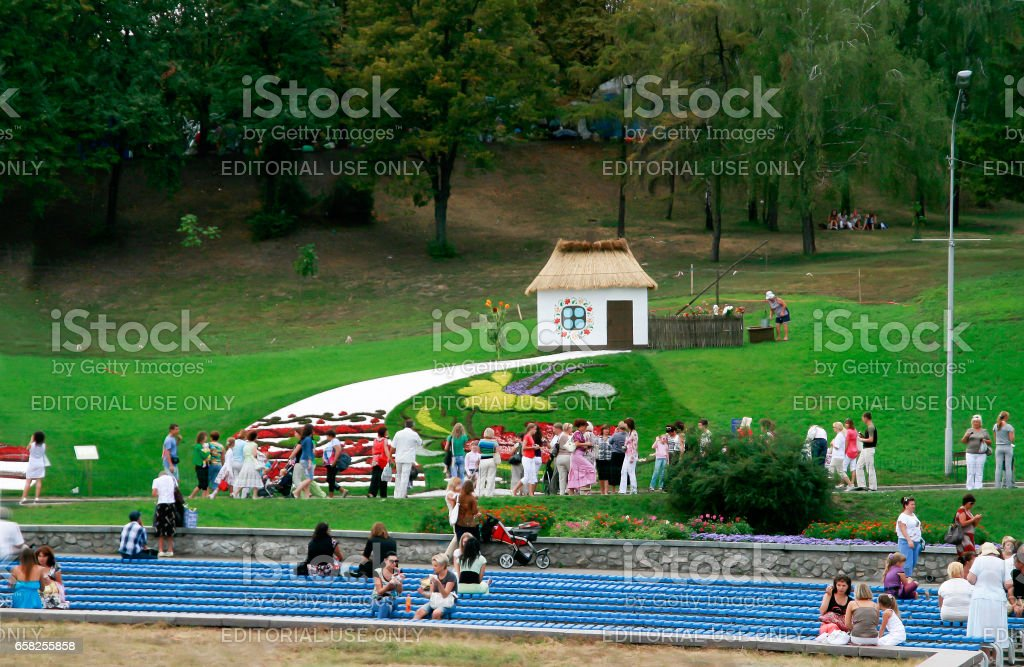 Kiev. Ukraine-August 25,2010: Annual flower show at the Song Festival Grounds. Flower Arrangement-a house in Ukrainian style with paintings on the walls. Visitors to view the exposition stock photo