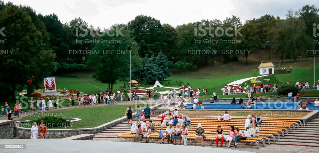 Kiev. Ukraine-August 25,2010: Annual flower show at the Song Festival Grounds. Flower composition-rushnyki with Ukrainian ornamenty. Visitors to view the exposition stock photo