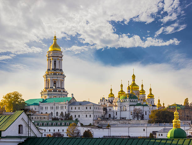 kiev-pechersk lavra against the sky with clouds autumn - ukrayna stok fotoğraflar ve resimler