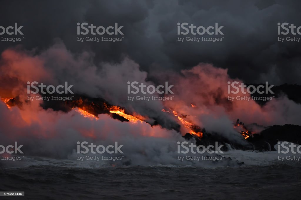 Kilauea Volcano Eruption in Hawaii, lava flowing into the Pacific Ocean. stock photo