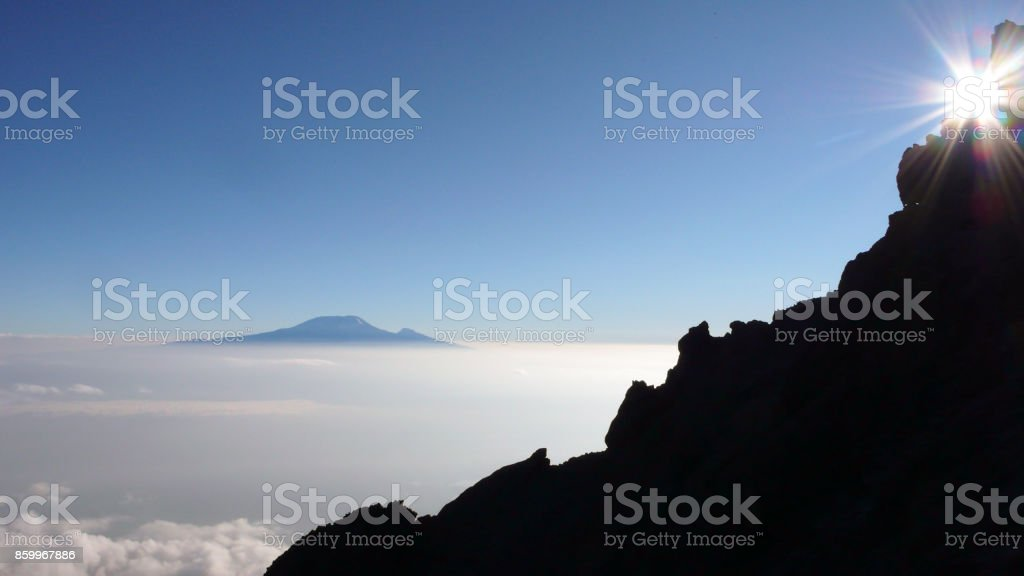 Kilimanjaro at sunrise as seen from Mount Meru stock photo