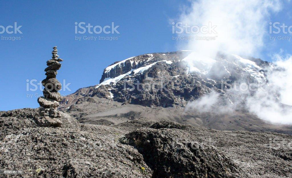 Kilimanjaro summit and cairn at high camp stock photo