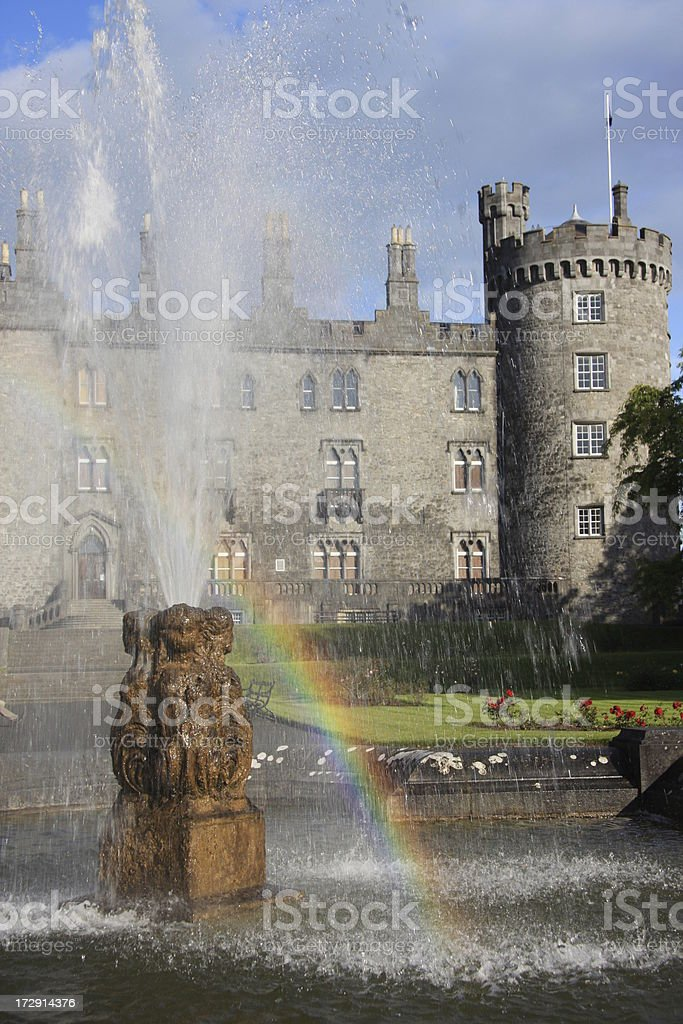 Kilkenny Castle behind fountain and rainbow stock photo