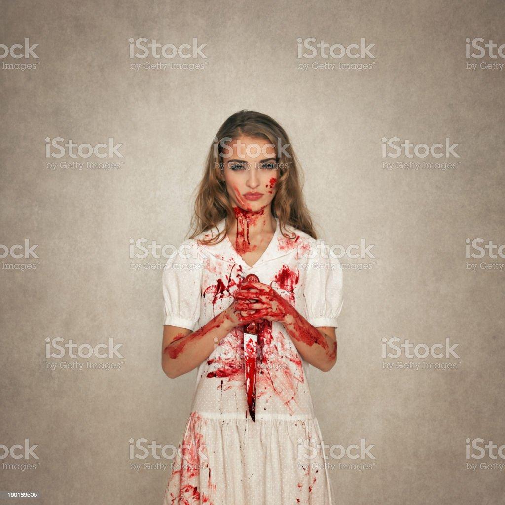 killer beauty holding bloody knife stock photo