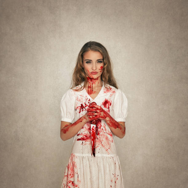 killer beauty holding bloody knife - killer stock photos and pictures