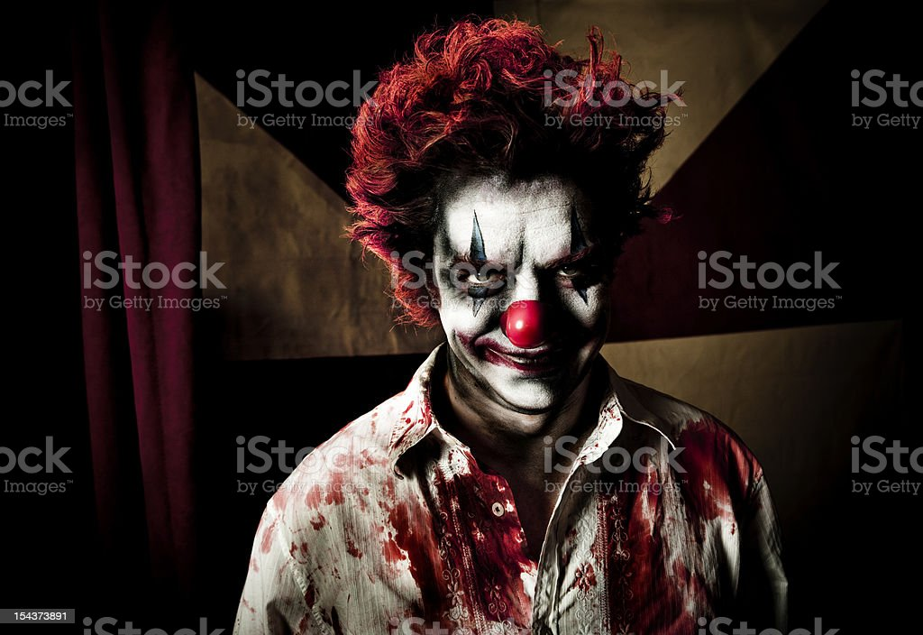 Killer Clown With An Evil Smile stock photo