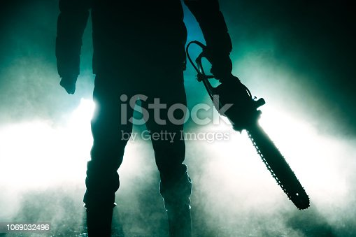 killer Holding Chainsaw