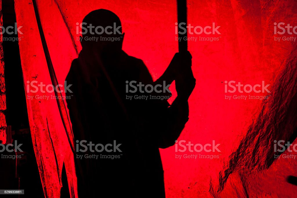 Killer silhouette with bat stock photo