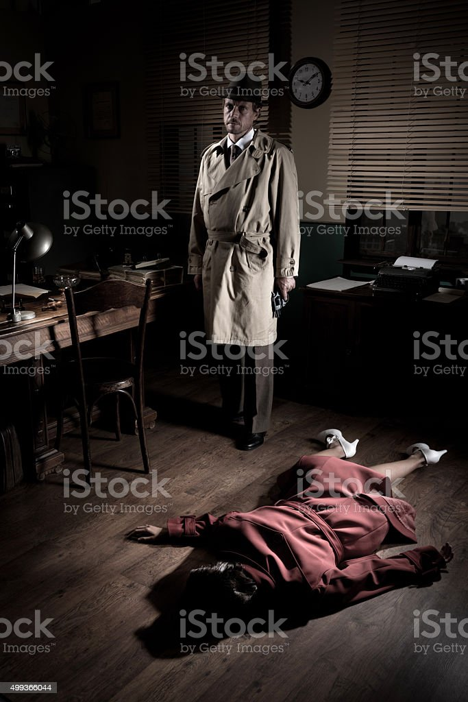 Killer with dead woman lying on the floor stock photo