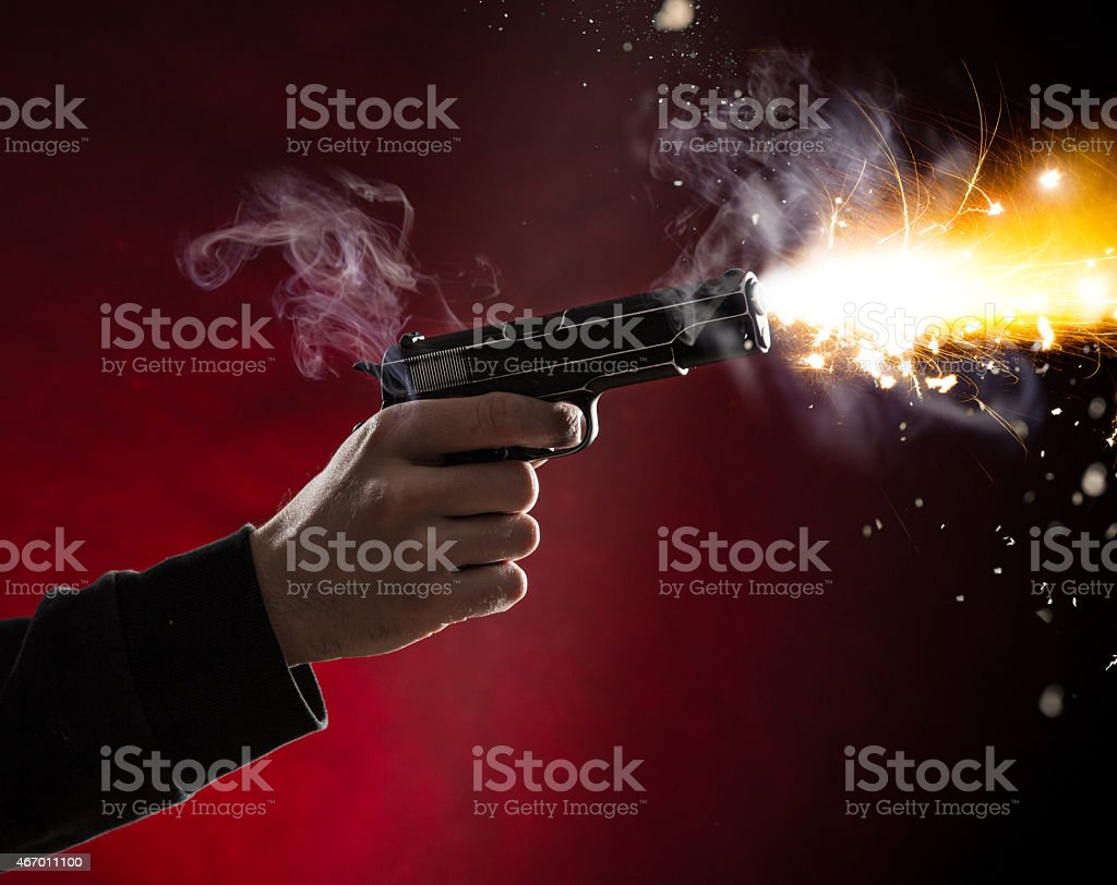 Killer with gun close-up stock photo