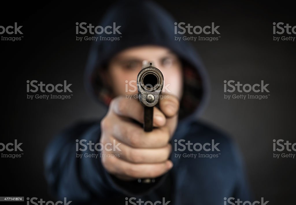 killer with gun stock photo