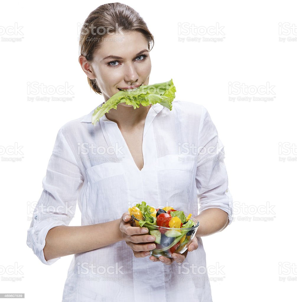 killing european woman & vegetable salad - isolated on white background stock photo