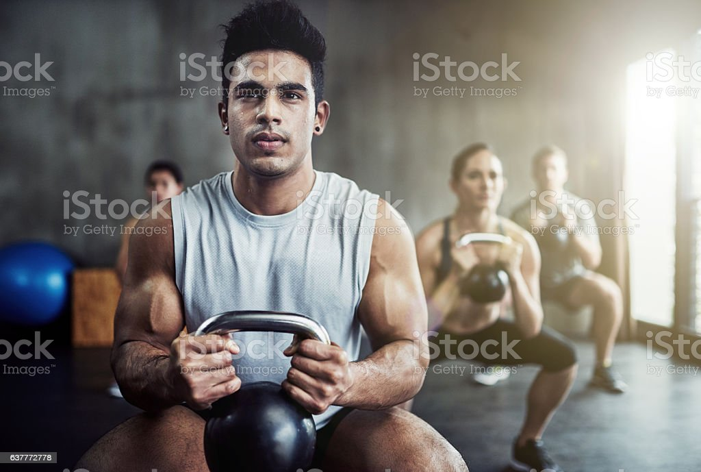 Killing that kettlebell workout stock photo