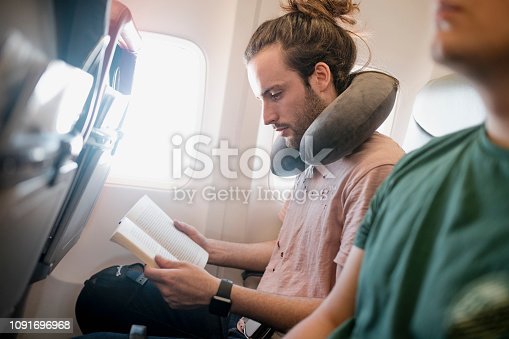 istock Killing Time on a Flight 1091696968