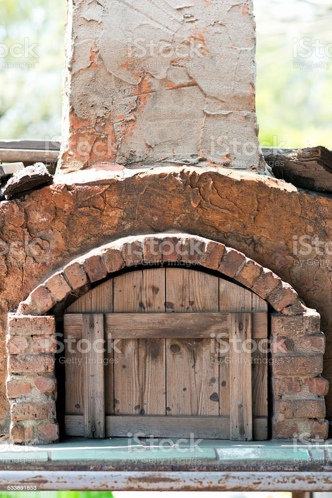 Kiln with wooden door for baking bread stock photo