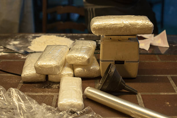 Kilos of cocaine Cocaine weighed into KG packets cocaine stock pictures, royalty-free photos & images