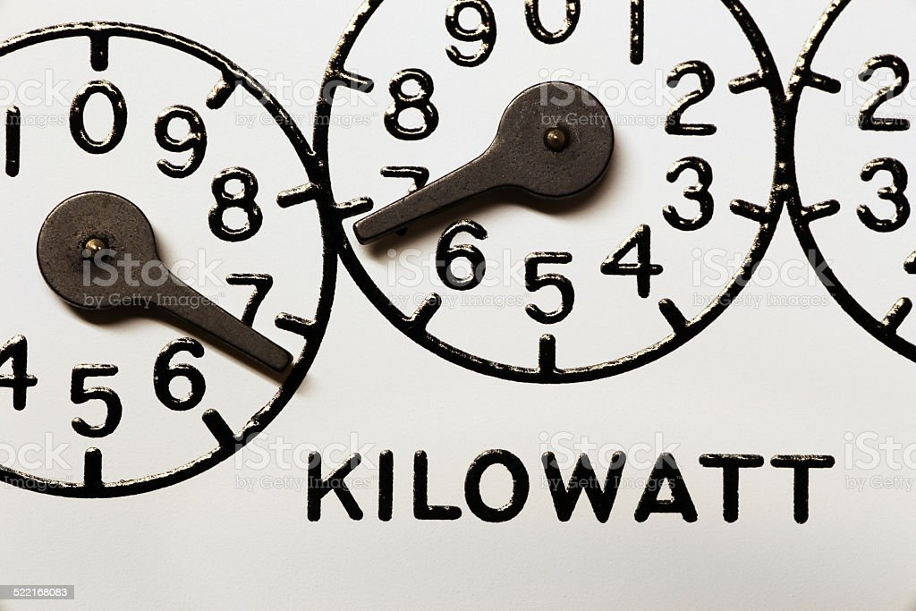 Kilowatt hour electric meter register dials and pointers stock photo