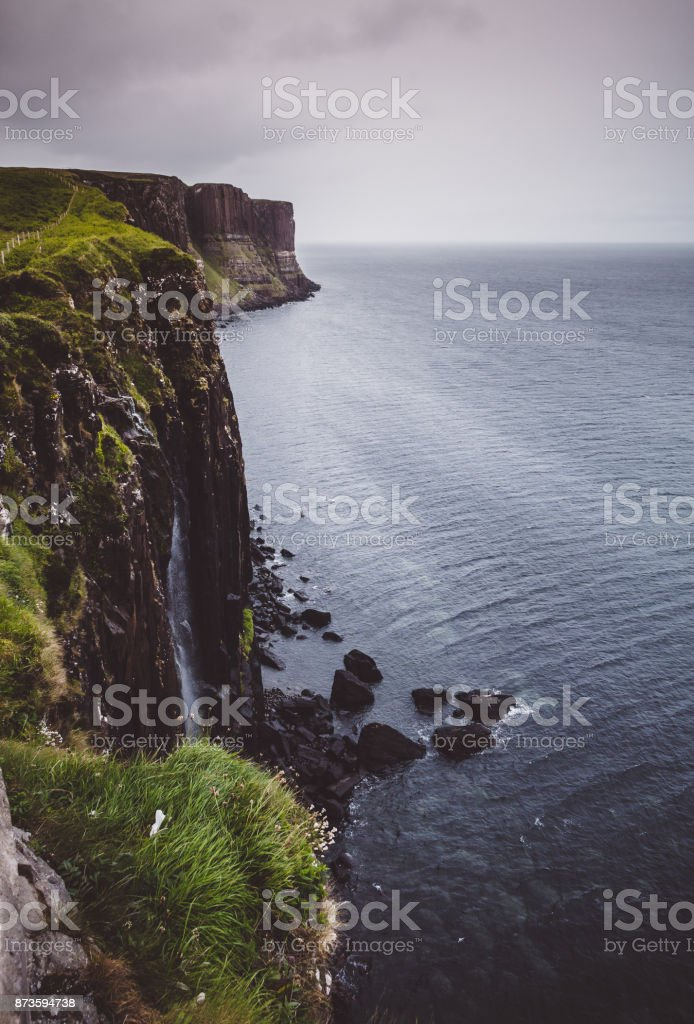Kilt Rock and Mealt Falls, on the eastern coast of the Isle of Skye, Scotland on a dark, stormy day. stock photo