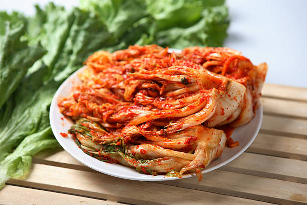 Kimchi dish served on a white plate Spicy Korean Kimchee kimchee stock pictures, royalty-free photos & images