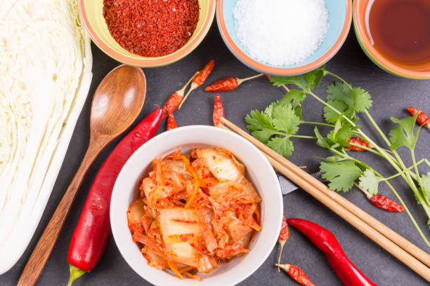Kimchi. Fermented napa cabbage with ingredients stock photo