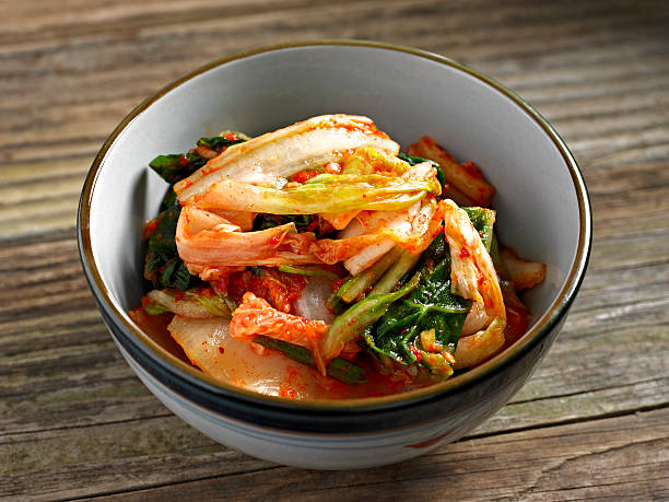 Kimchi Kimchi in a Bowl. kimchee stock pictures, royalty-free photos & images