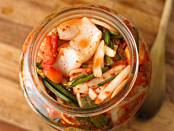 Kimchi Fresh Kimchi in Glass Bottle. kimchee stock pictures, royalty-free photos & images