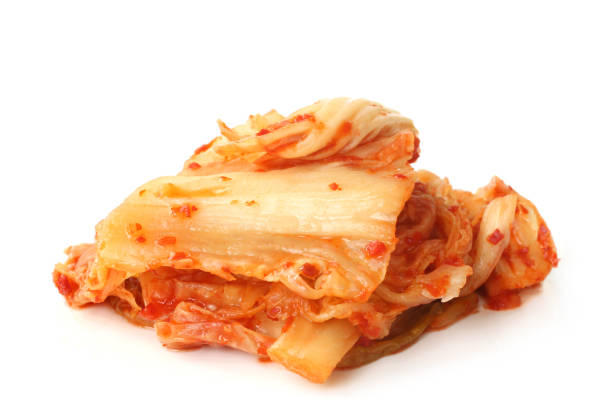 Kimchi Kimchi on white background kimchee stock pictures, royalty-free photos & images