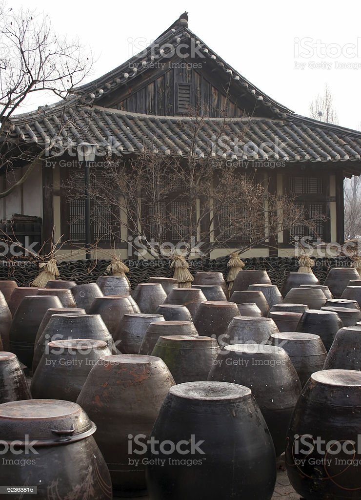 Kimchi pots in front of a traditional Korean home royalty-free stock photo