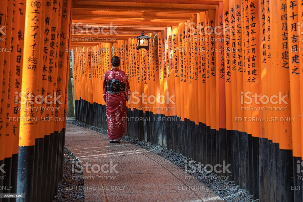 Kimono girl in Fushimi inari shrine. stock photo
