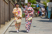 Kimono Wearing Traditional Young Japanese Women Walking in Gion Kyoto