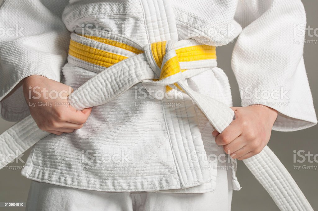 Kimono with yellow belt stock photo