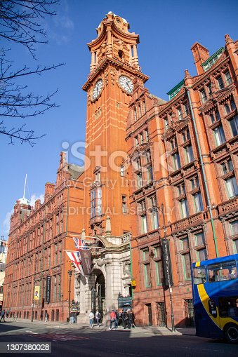 Manchester England - 13.10.2013: Kimpton Clocktower Hotel (with Palace lettering) on blue sky sunny day on Oxford Street