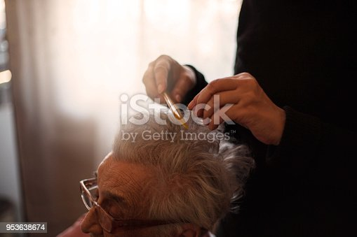 Senior woman having help for her hair.