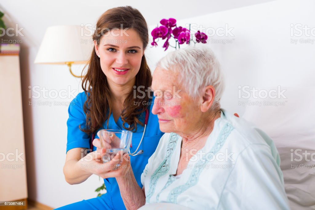 Kind Caregiver Helping stock photo