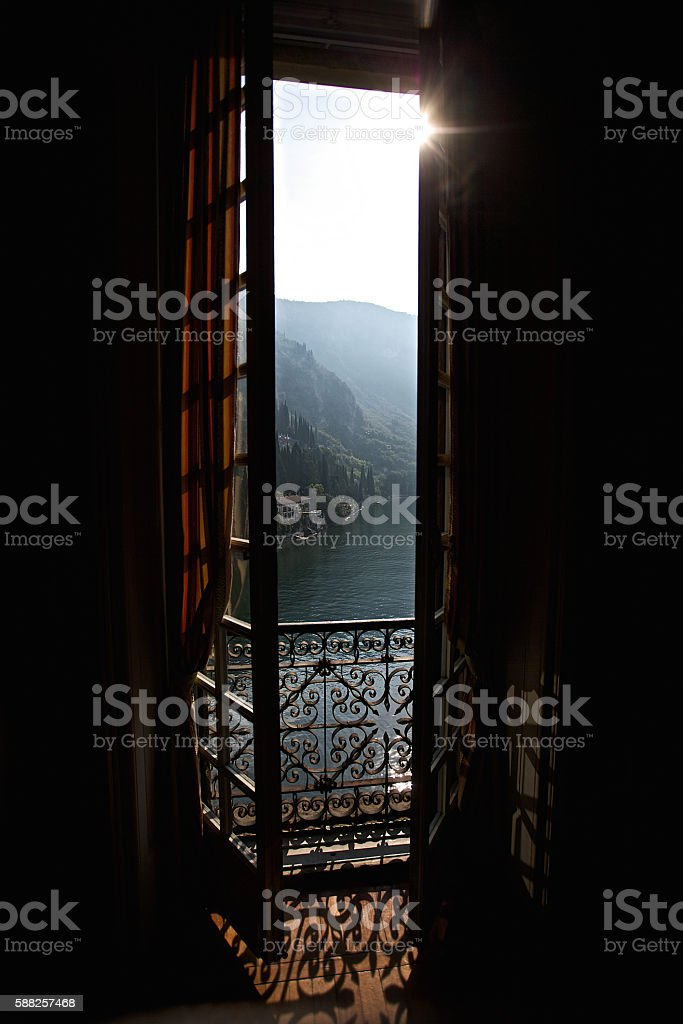 Kind through a window on mountain landscape stock photo